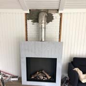 Gas fireplace in an existing chimney