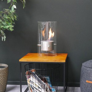 Circular and exclusive tabletop bio fireplace in steel. Featuring a burning time of up to 3h.