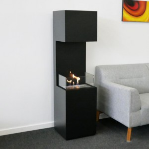 Freestanding bio fireplace opened on three sides making flames more visible.