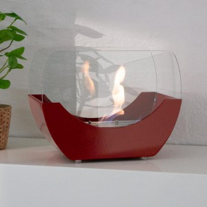 Red cradle shaped fireplace with glass panels- the 1 L burner provide up to 2,5 h of burning.